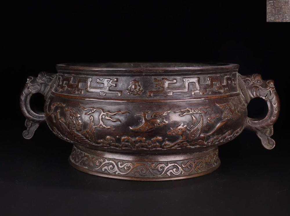 A BRONZE MYSTICAL BEAST WITH DOUBLE DRAGON SHAPED EARS CENSER