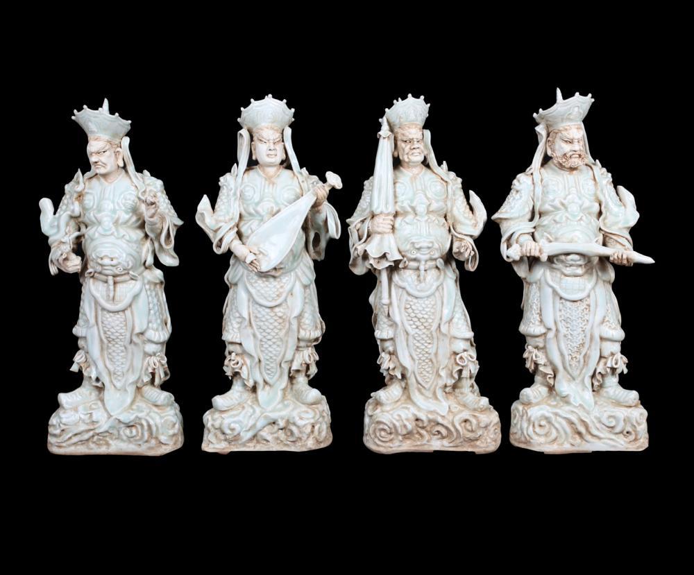 A SET OF CELADON GOOD-WEATHER BUDDHAS