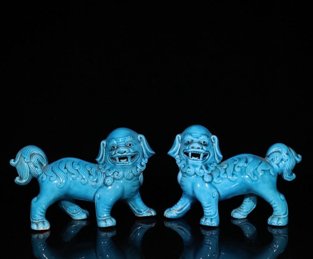 A PAIR OF OLD BLUE GLAZED PORCELAIN ORNAMENTS SHAPED LION