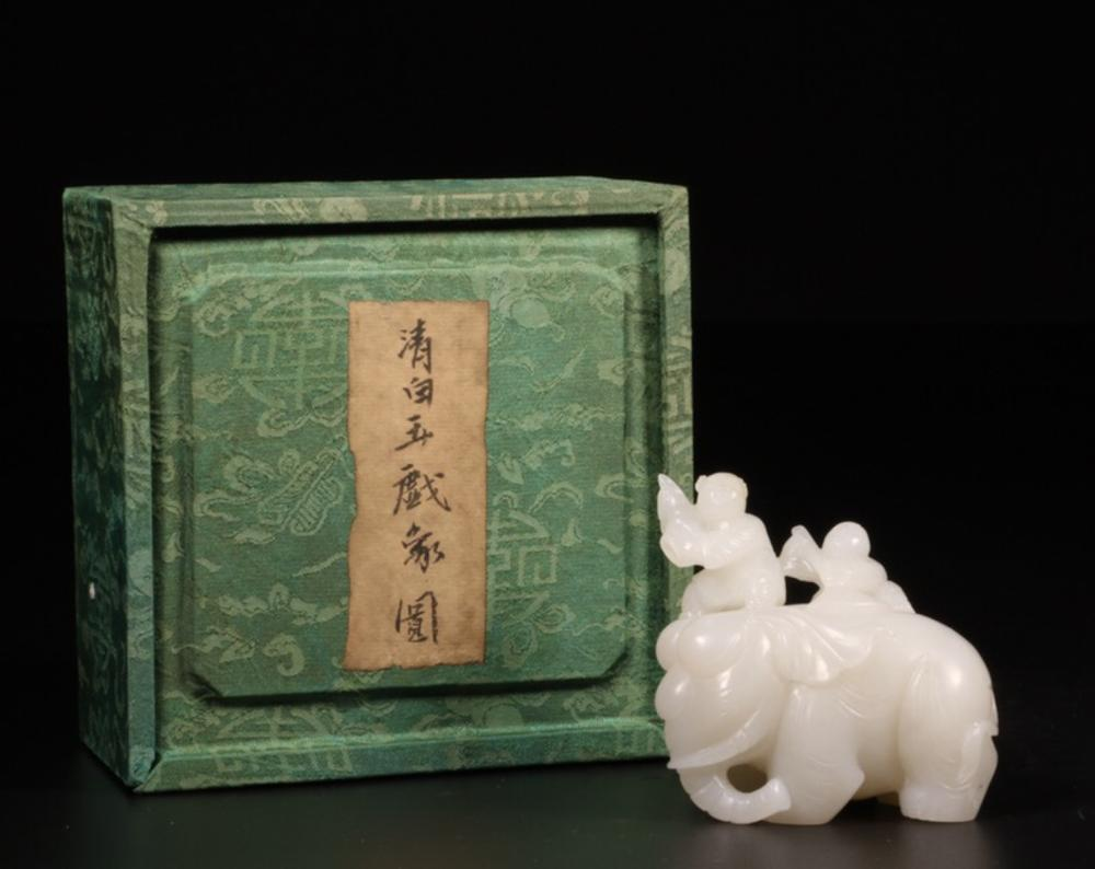 A HETIAN JADE ORNAMENT OF STORY-TELLING SHAPED
