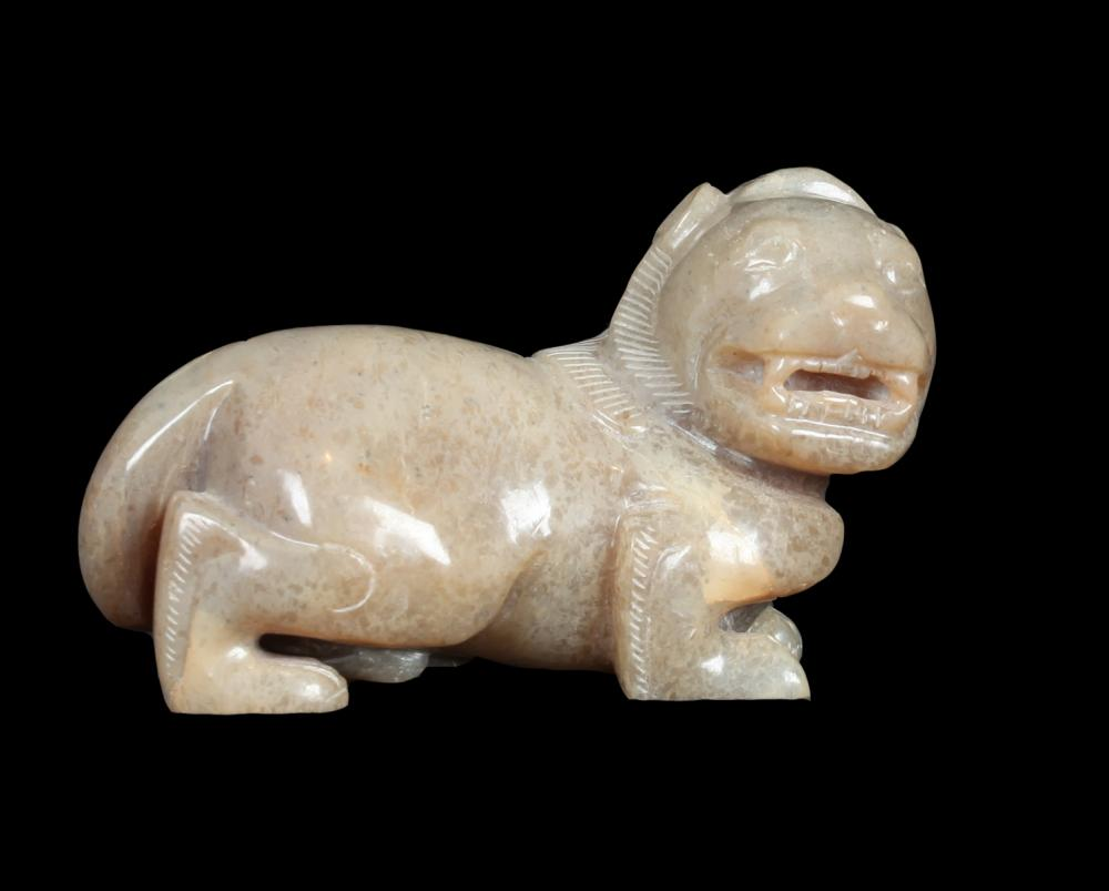 A JADE ORNAMENT IN LION SHAPE