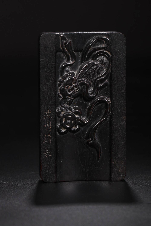 Lot 19: A ZITAN WOOD INK SLAB BY SHEN SHUYONG