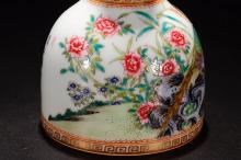 Lot 25: A YONGZHENG MARK AUSPICIOUS FLOWERS PAINTED FAMILLE ROSE VASE