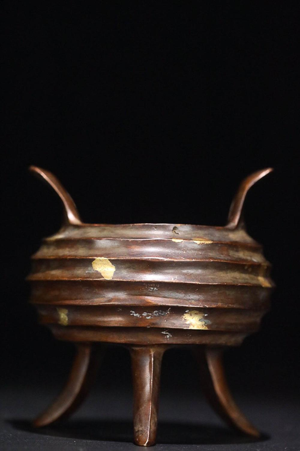 17-19TH CENTURY, A BRONZE TRIPLE FOOT DOUBLE EAR FURNACE, QING DYNASTY