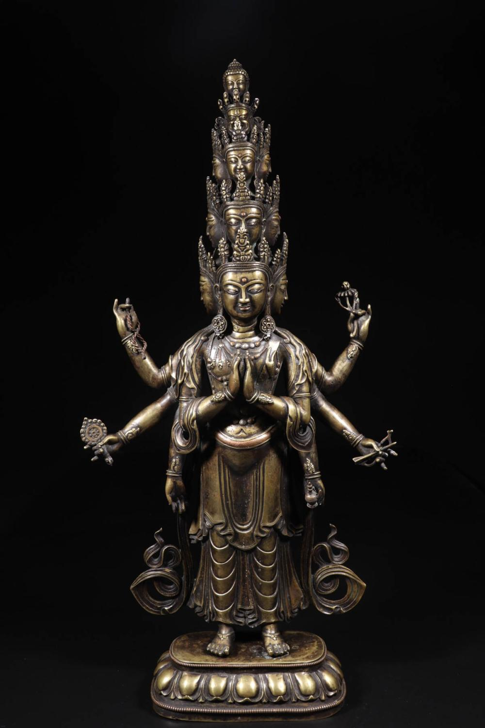 A GILT BRONZE 11 FACES 8 ARMS BUDDHA