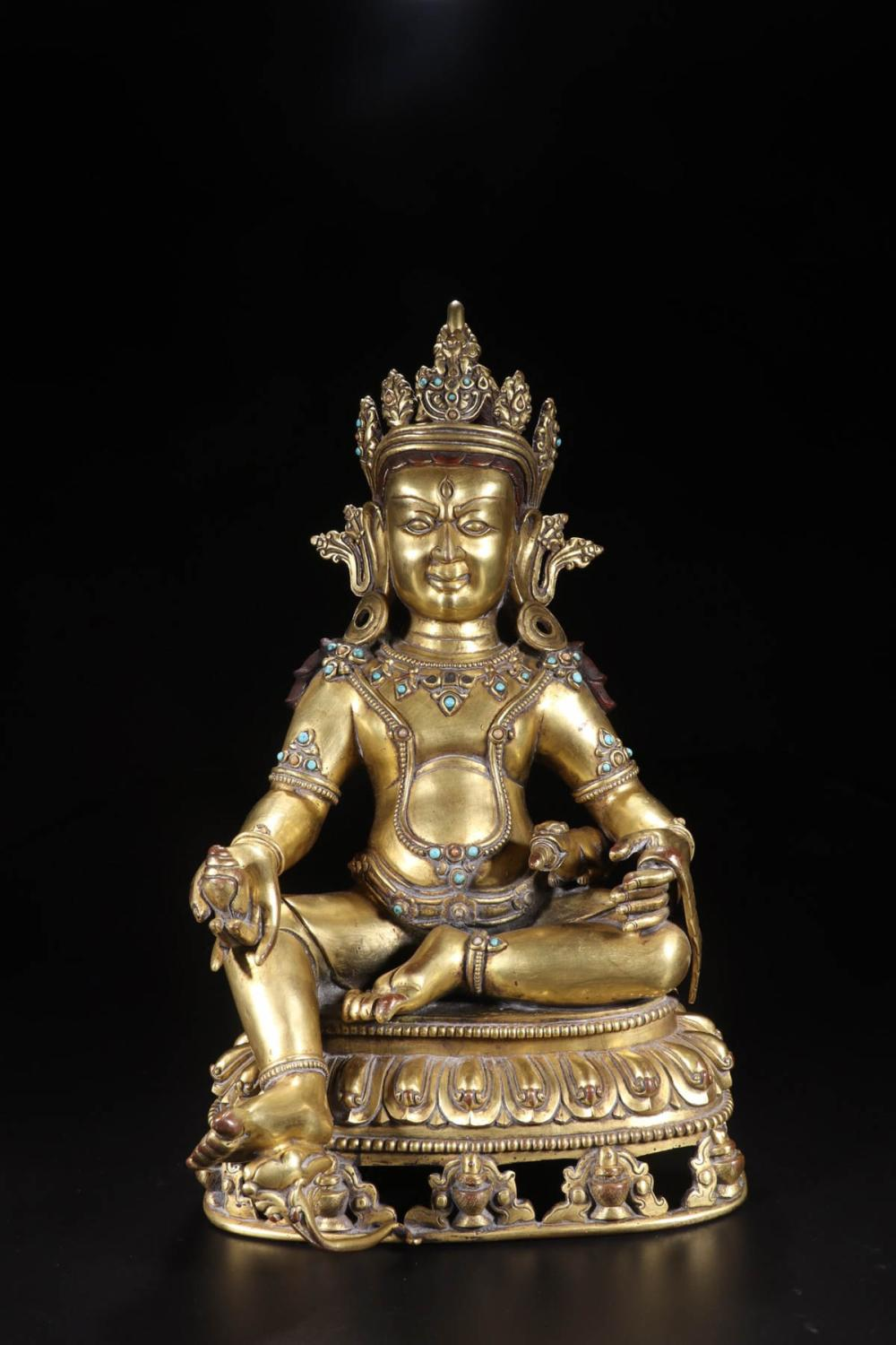 A GILT BRONZE EMBEDED WITH SONG STONE WEALTH BUDDHA