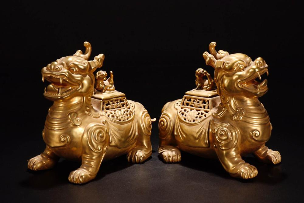 A  PAIR OF GILDING YONGZHENG MARK AUSPICIOUS BEASTS