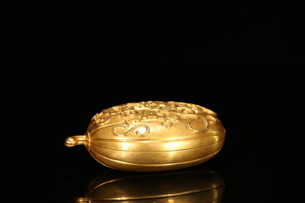 A GILT BRONZE BOX