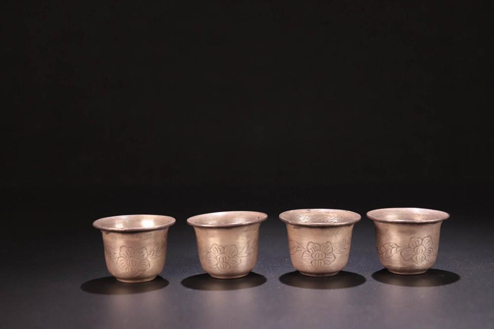 A SET OF FLORAL DESIGN PURE SILVER CUPS