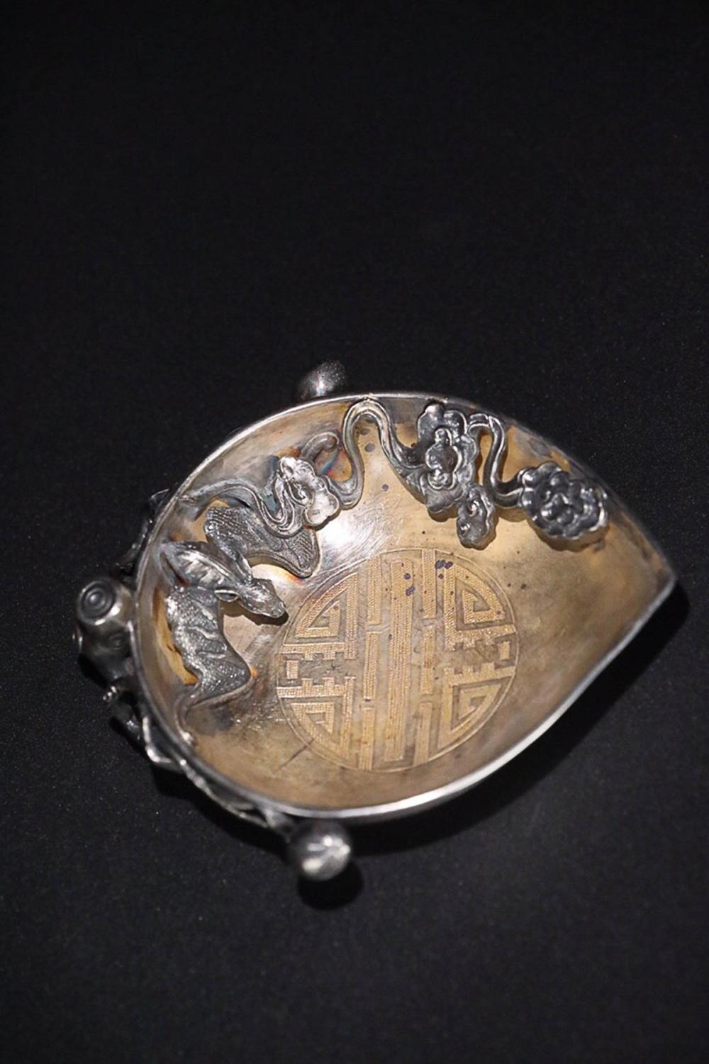 A STORY DESIGN GILT SILVER BRUSH PLATE