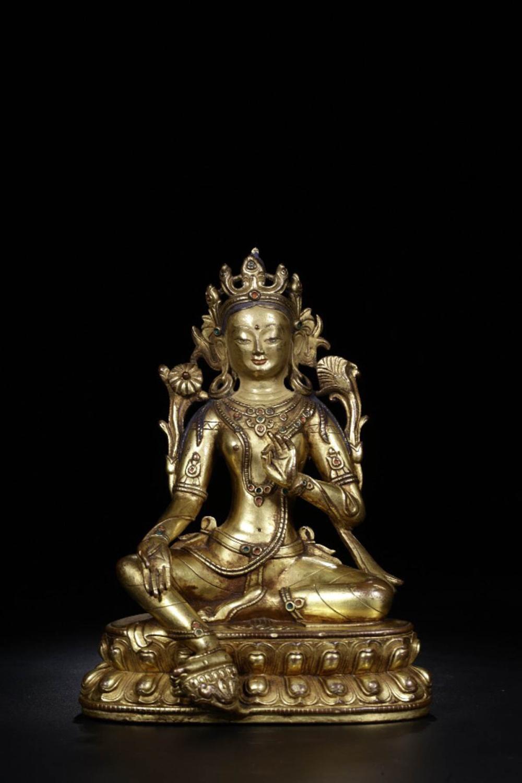 A GILT BRONZE DUMU BUDDHA