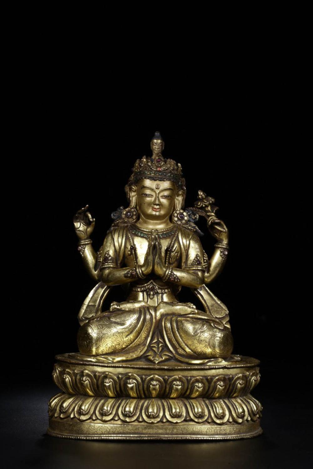 A GILT BRONZE FOUR ARMS GUANYIN BUDDHA