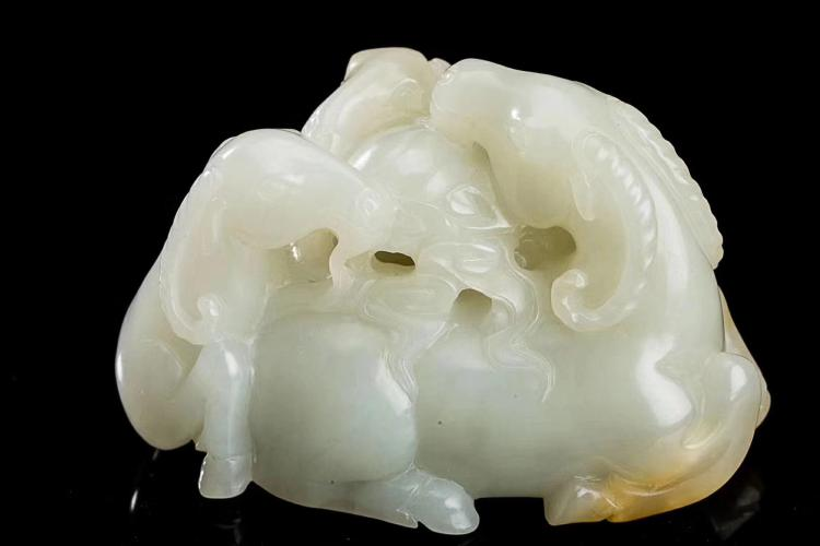 A HEITIAN WHITE JADE HOLLOW-OUT PAPERWEIGHT ORNAMENT