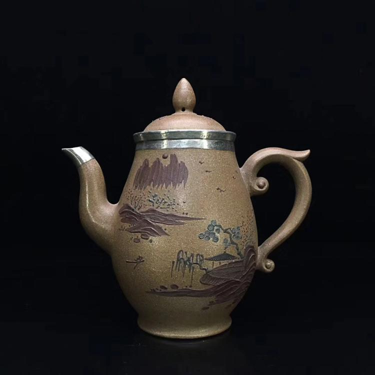 A PURPLE CLAY SILVER-CLAD TEAPOT