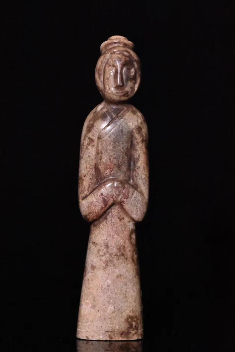 A COLLECTION LEVEL STANDING TOMB FIGURE