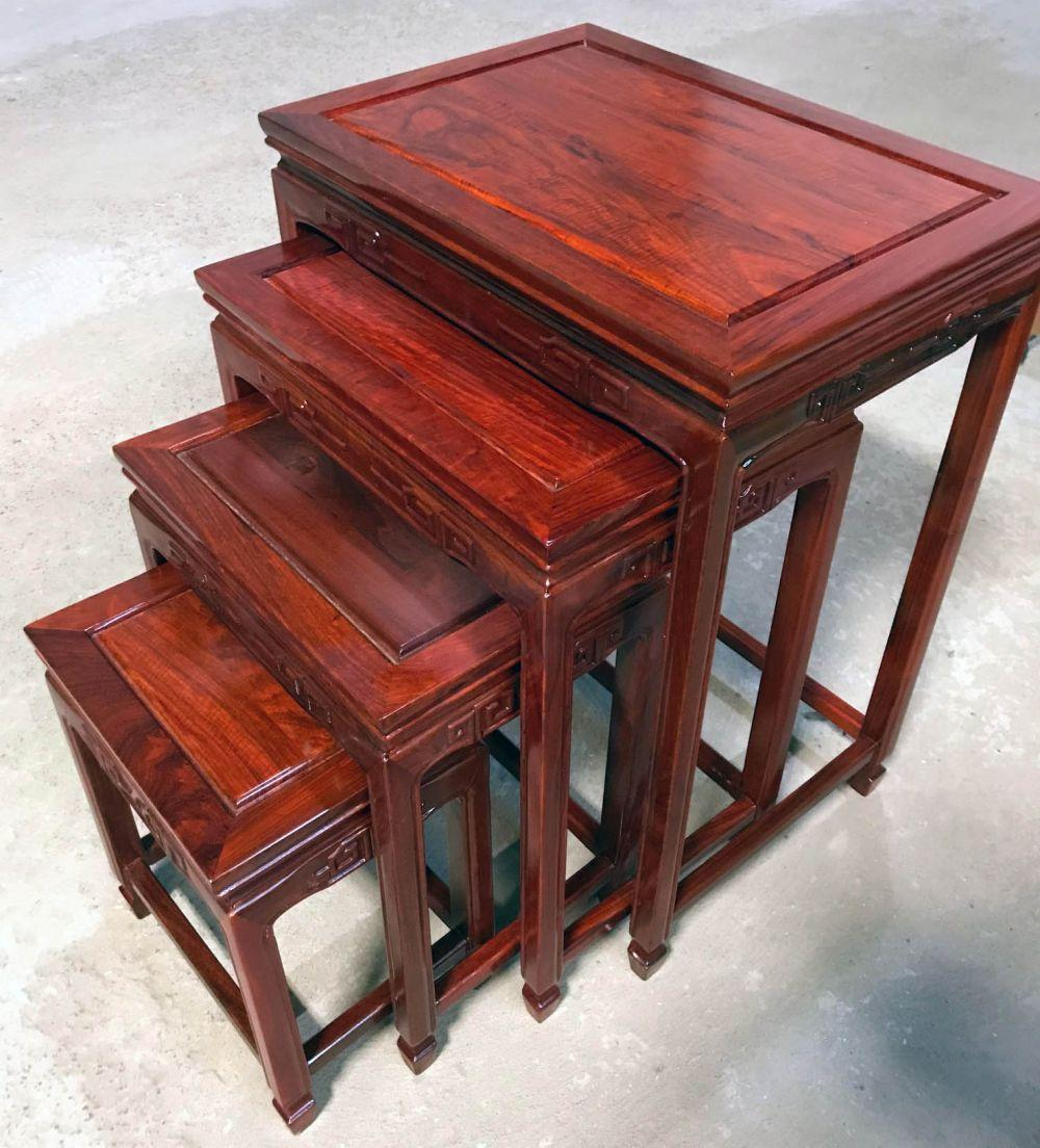 Nest of 4 carved rosewood tables