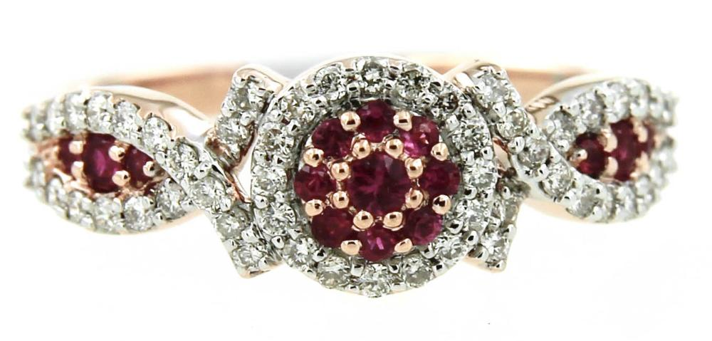 Lot 463: 14 kt pink gold ring with rubies and diamond