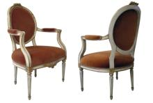 A pair of Swedish Gustavian style ivory painted armchairs