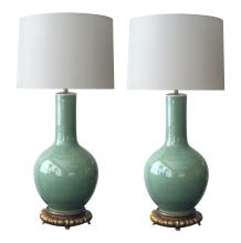 A pair of Chinese bottle-form celadon lamps on gilt wood bases