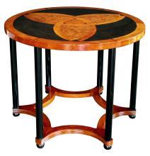 An Austrian art deco amboyna inlaid circular table