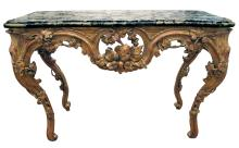 A curvaceous and finely carved French regence gilt-wood console table with grape vine motif and sage green marble top