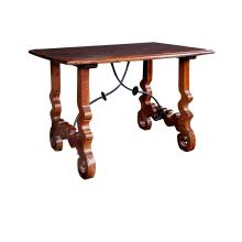 A rustic and well-patinated Spanish baroque style walnut trestle table with iron stretcher