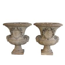 An exceptional and good quality pair of Italian neoclassical style campagna-form hand-carved terracotta urns