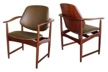 A mod pair of Danish Arne Hovmand-Olsen 1960's teak armchairs with leather upholstery