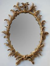 A good quality English George II rococo gilt wood oval foliate-carved mirror