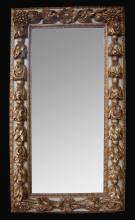 A large-scaled and deeply carved continental baroque style ivory painted and parcel-gilt rectangular mirror; possibly German