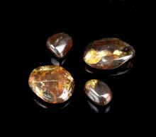Four Natural Blood Amber Pieces