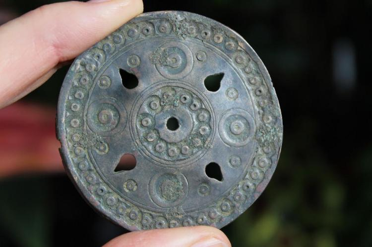 Ancient perforated Islamic bronze pendant-mirror with 5 holes, c.1000-1100 AD