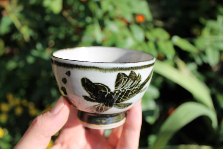 Chinese beautiful porcelain tea cup with black fish, Qing Dynasty style;