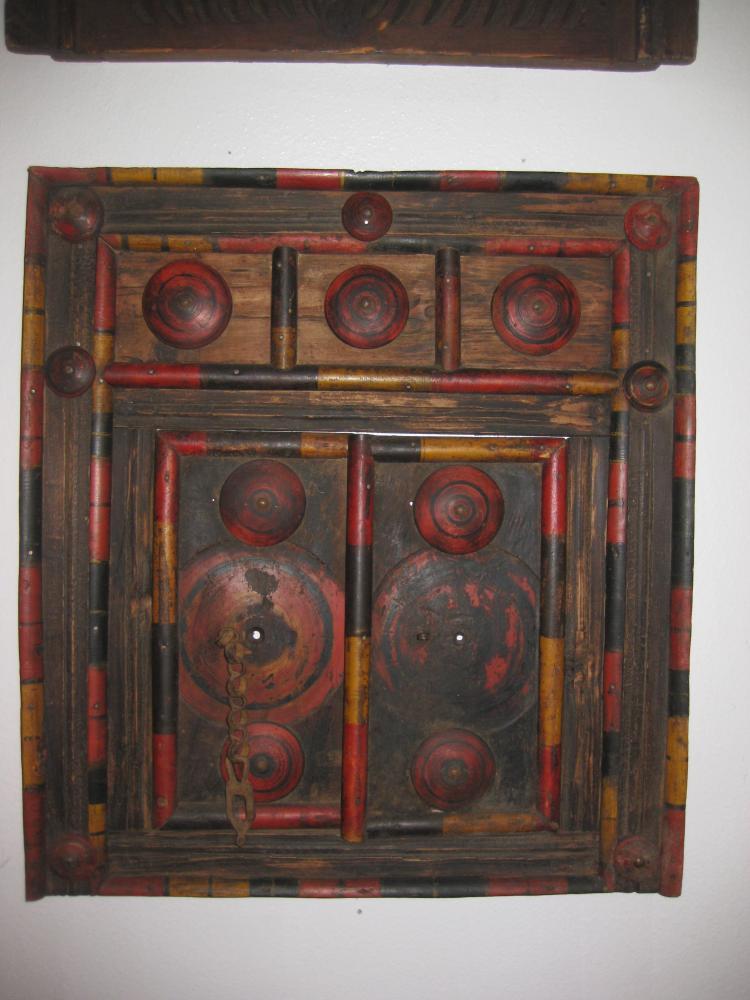 Antique red Afghani carved wood window, Nuristan, Afghanistan