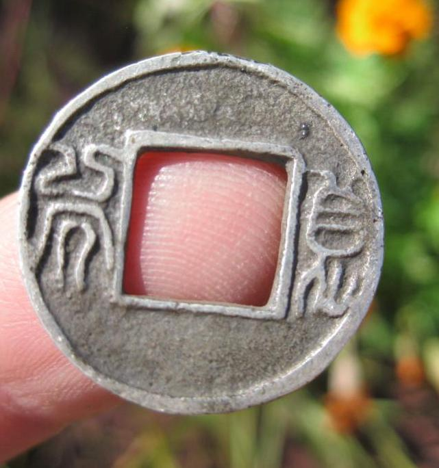 Chinese Han Dynasty silver coin carved