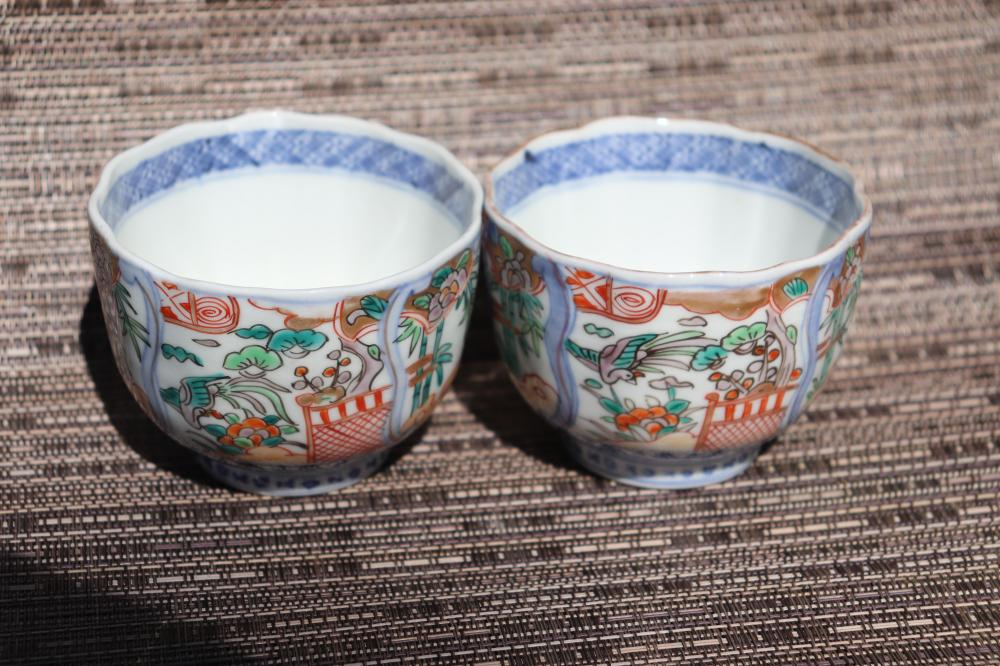 Pair of antique Japanese (Chinese?) porcelain sake cups with a seal