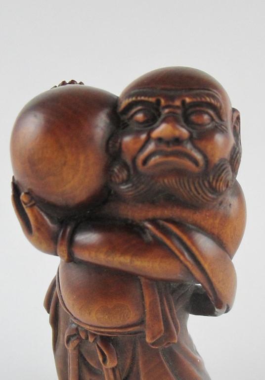 A japanese carved boxwood okimono