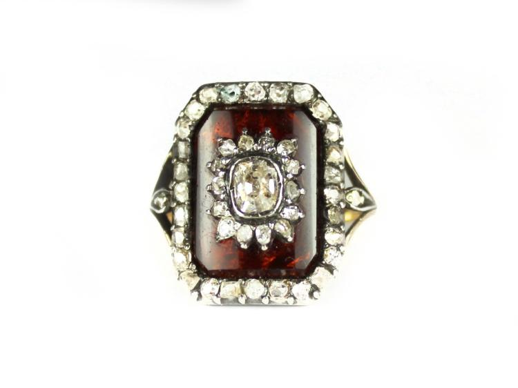 an antique dress ring in yellow gold and platinum t