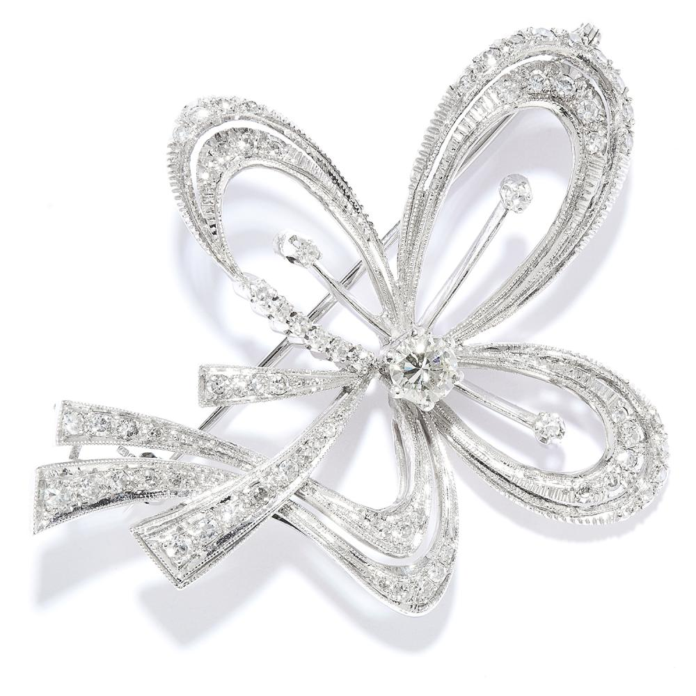 DIAMOND RIBBON BROOCH in 18ct white gold, designed as a ribbon and bow motif, set with a central diamond of 0.42 carats with further round cut diamonds, totalling 1.20-1.50 carats, stamped 750, 5.4cm, 11.5g.