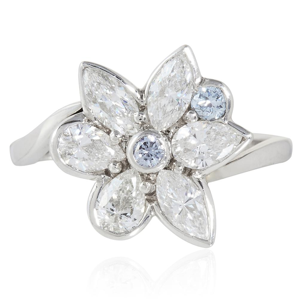 BLUE DIAMOND AND WHITE DIAMOND DRESS RING, HIRSH in platinum, depicting a flower set with two round cut blue diamonds of 0.12 carats, and pear and marquise cut diamonds totalling 1.25 carats, signed Hirsh, stamped 950, size L / 6, 5.79g.