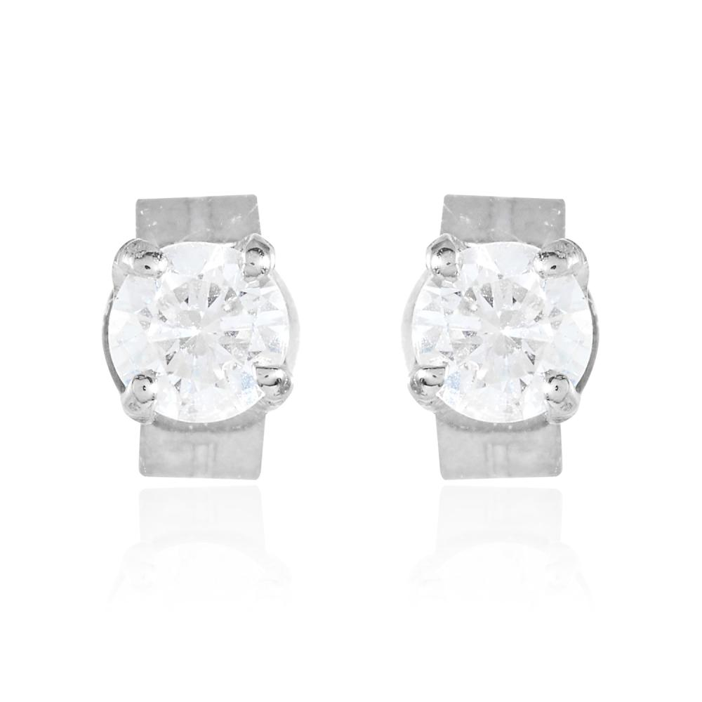 A PAIR OF 0.32 CARAT DIAMOND EAR STUDS in 18ct white gold, each set with a round cut diamond totalling approximately 0.32 carats, stamped 750, 0.96g.