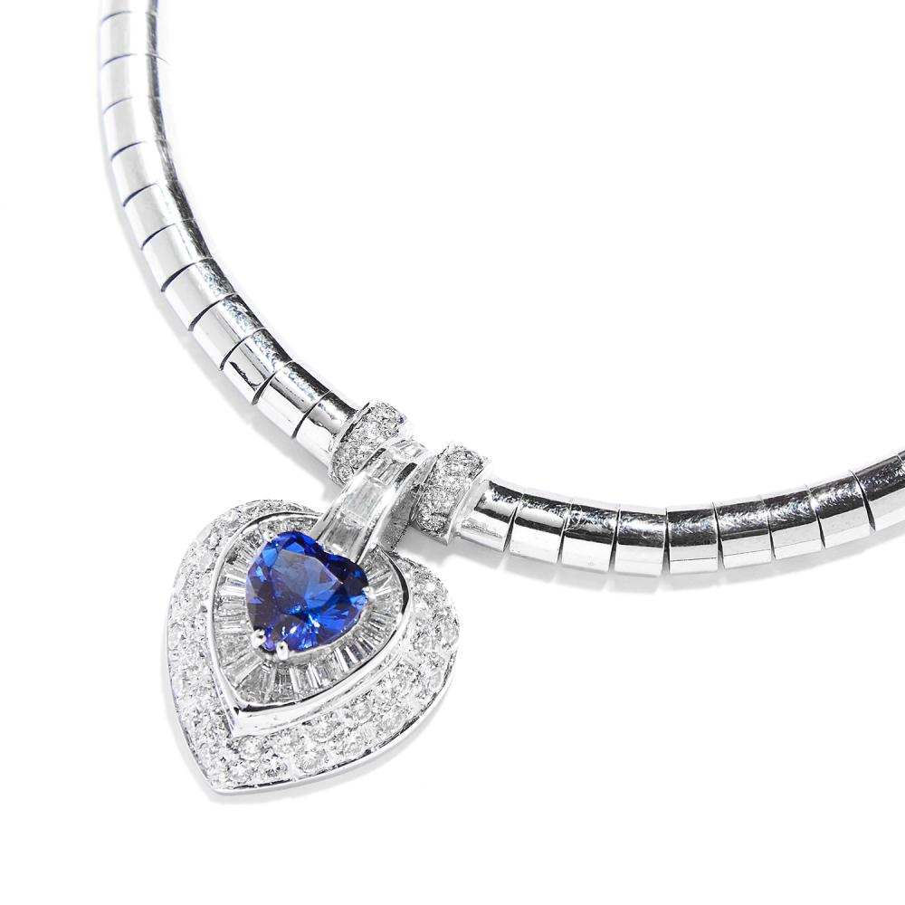 TANZANITE AND DIAMOND PENDANT NECKLACE in 18ct white gold, the fancy link chain suspending a heart shaped drop, set with a tanzanite of 2.07 carats within concentric borders of round and step cut diamonds