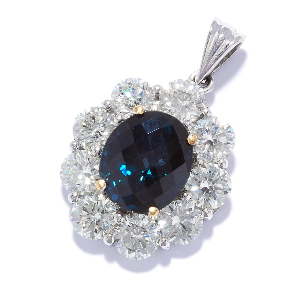 SAPPHIRE AND DIAMOND PENDANT in white gold or platinum, set with a faceted sapphire, in a cluster of round cut diamonds totalling approximately 2.97 carats, unmarked, 2.5cm, 4.68g.