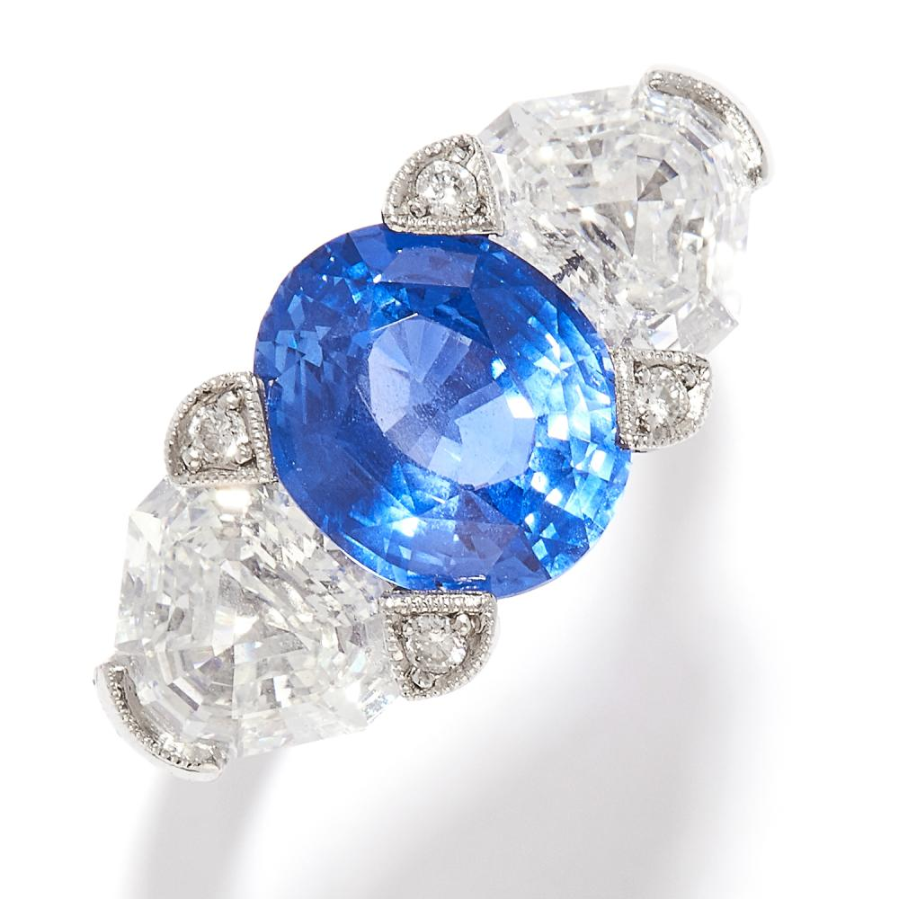 3.80 CEYLON NO HEAT SAPPHIRE AND DIAMOND RING in platinum, the oval cut sapphire of 3.80 carats between fancy shaped step cut diamonds totalling 2.51 carats, with further diamond accents, stamped Plat, size M / 6, 8.4g.