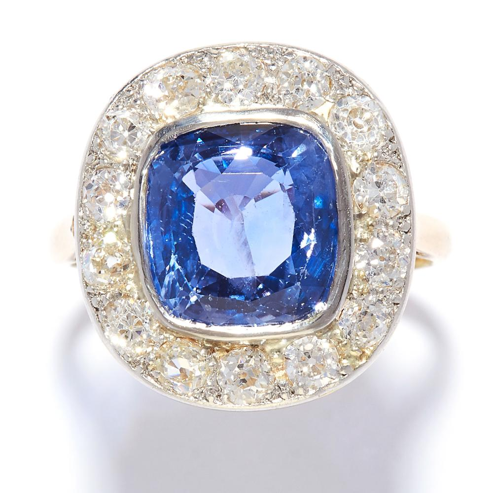 4.65 CARAT NO HEAT SAPPHIRE AND DIAMOND CLUSTER RING in yellow gold, set with a 4.65 carat  cushion cut sapphire in a cluster of old cut diamonds, unmarked, size L / 6, 5.24g. GCS report, no heat treatment.