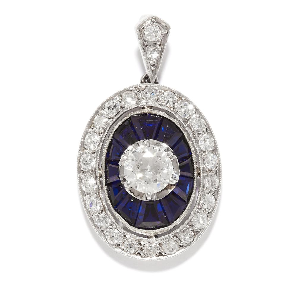 DIAMOND AND SAPPHIRE PENDANT in platinum, the central round cut diamond of 0.50 carats within borders of calibre cut sapphires and single cut diamonds, unmarked, 2.8cm, 3.6g.