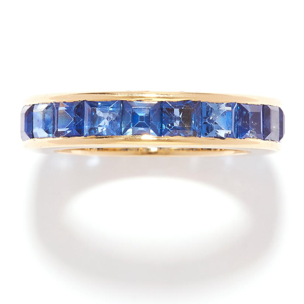 SAPPHIRE ETERNITY BAND RING in 18ct yellow gold, set with square cut sapphires, British hallmarks, size J / 5, 4.57g.