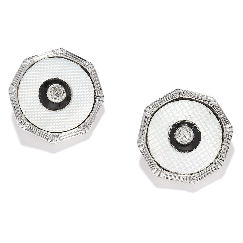 A PAIR OF ANTIQUE ENAMEL, DIAMOND AND ONYX EAR STUDS in 18ct yellow gold and platinum, each set with white enamel, onyx and a round cut diamond, stamped PLAT 18CT, 3.02g.