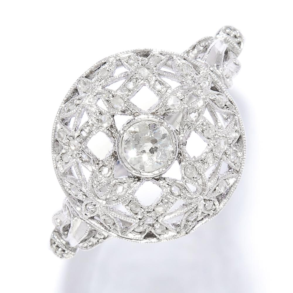 ANTIQUE DIAMOND DRESS RING in 18ct white gold, set with an old and rose cut diamonds in open floral framework, stamped 18CT, size T / 9.5, 4.35g.