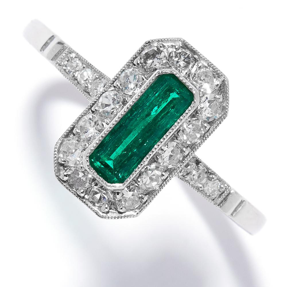 EMERALD AND DIAMOND DRESS RING in platinum, set with an emerald cut emerald in a cluster of old cut diamonds, stamped 950, size O / 7, 2.70g.